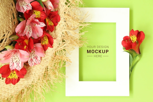 Flat lay mockup frame with straw hat decorated tropical flowers