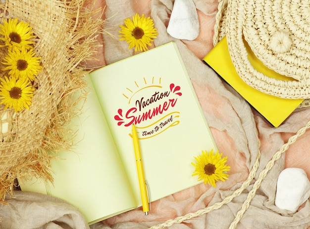 Flat lay mockup notes with straw hat and bag