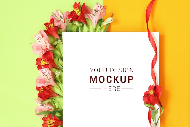 Flat lay mockup template with flowers on green yellow background