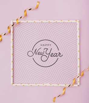 Flat lay new year lettering with simple frame