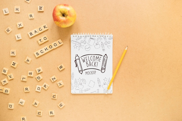 Flat lay notebook and apple arrangement