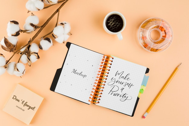Flat lay notebook and cotton arrangement