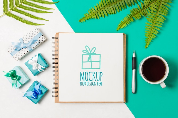 Flat lay notebook mock-up next to birthday gifts