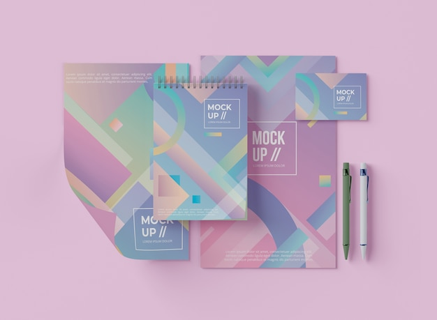 Flat lay of notebook with paper and geometric design