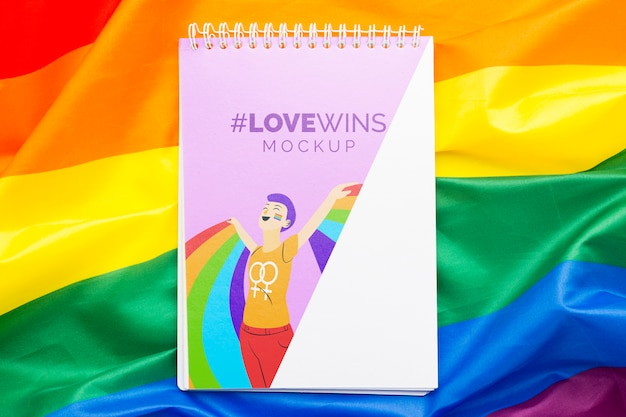 Flat lay of notebook with rainbow for pride