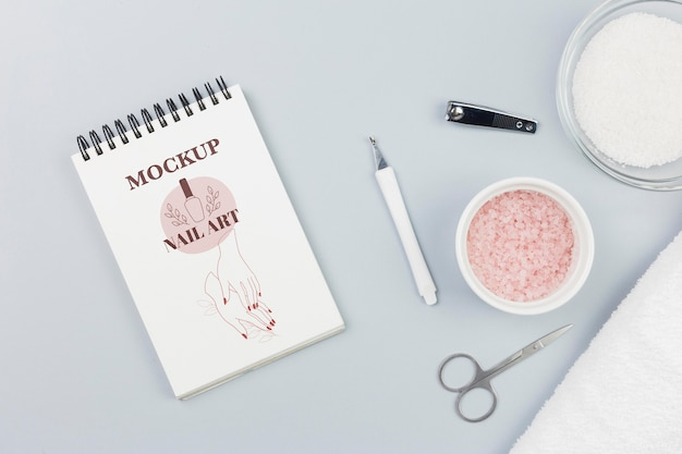 Flat lay notepad and bath salt spa mock-up