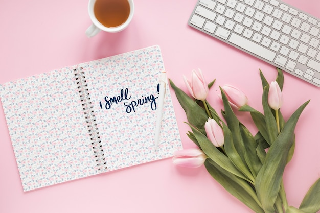 Flat lay notepad mockup for spring