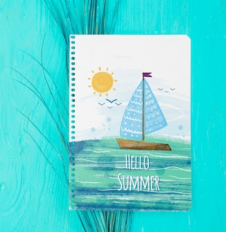 Flat lay notepad mockup with summer elements