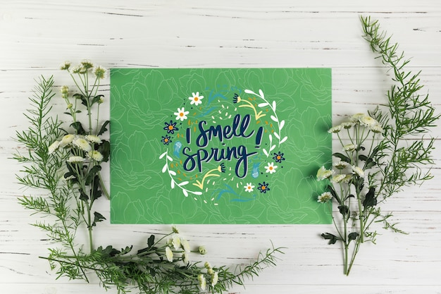 Flat lay paper card mockup with spring concept