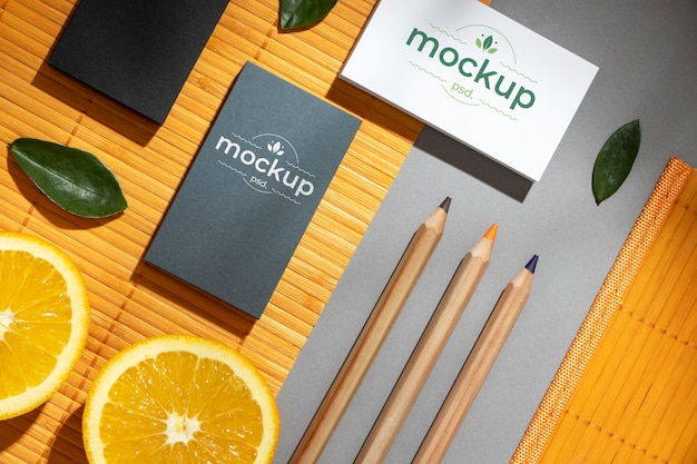 Flat lay of paper stationery with citrus and pencils