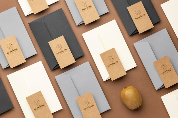 Flat lay of paper stationery with kiwi