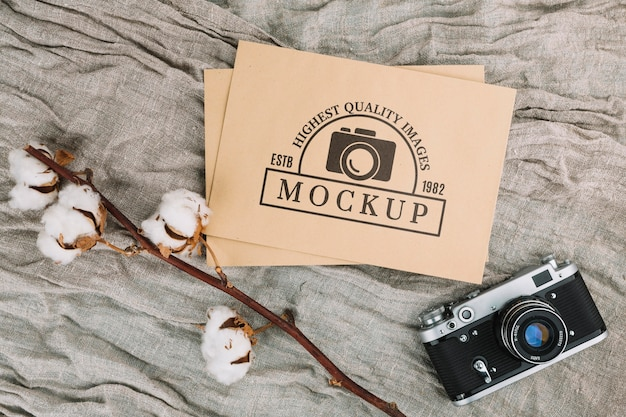 Flat lay photo camera mockup with cotton