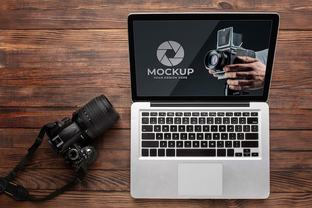 Flat lay of photographer wooden workspace with laptop