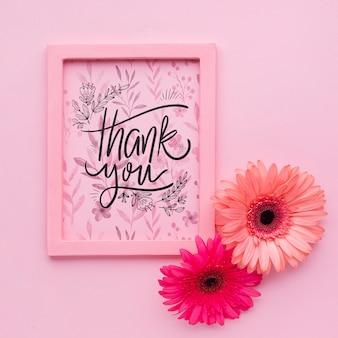 Flat lay of pink frame on pink background