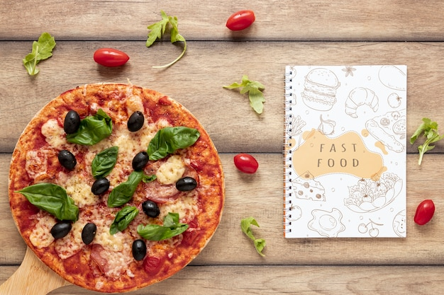 Flat lay of pizza on wooden background