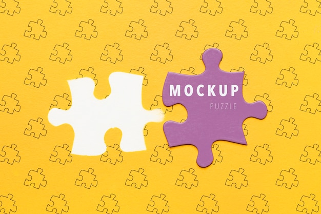 Flat lay purple piece of puzzle mock-up