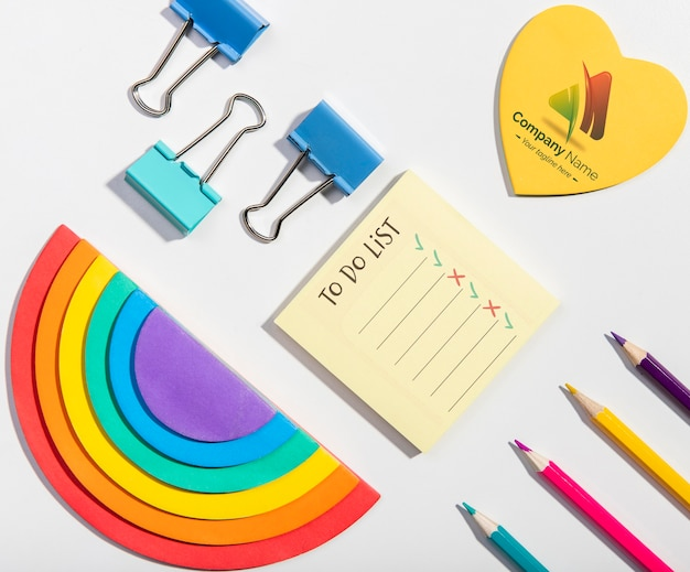 Flat lay rainbows and pencils knolling desk concept