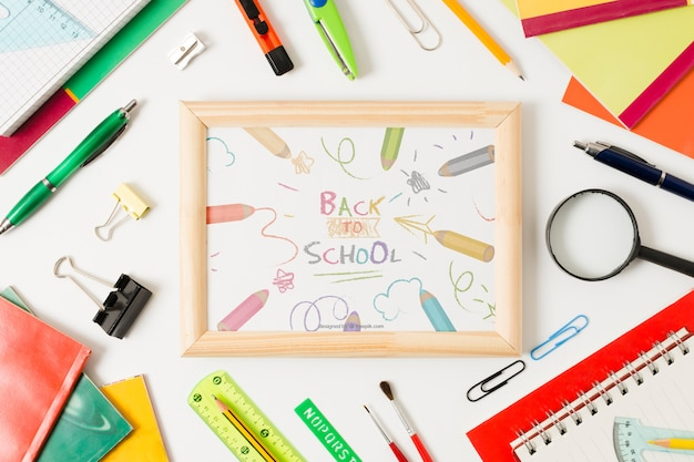 Flat lay school arrangement with board on white background