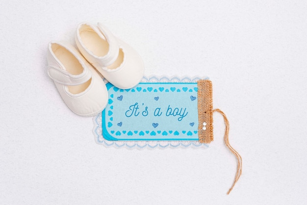 Flat lay of shoes with baby shower decoration