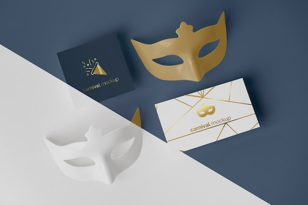 Flat lay of simplistic carnival invitation with masks