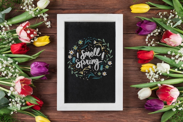 Flat lay slate mockup with spring concept