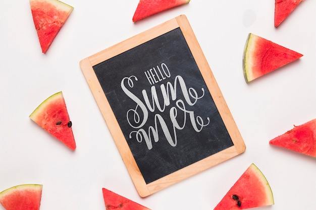 Flat lay slate mockup with watermelons