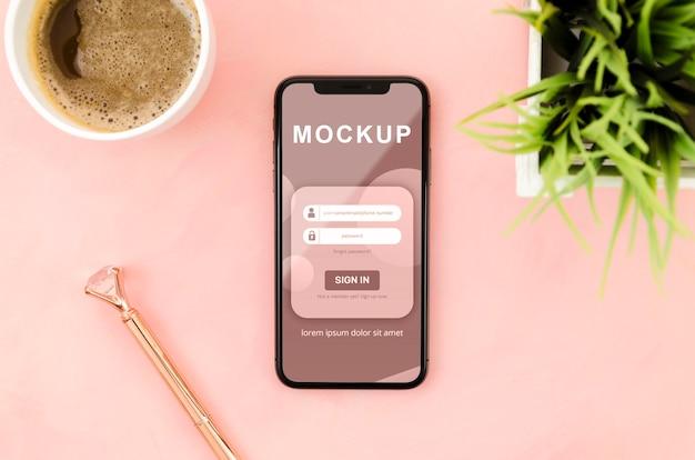 Плоский макет смартфона с кофе и растением
