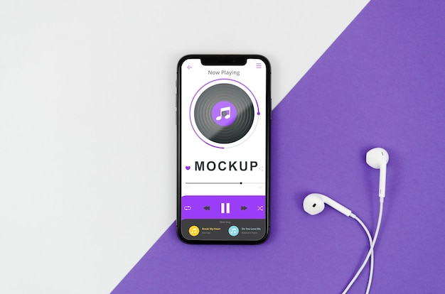 Flat lay smartphone mock-up with earphones