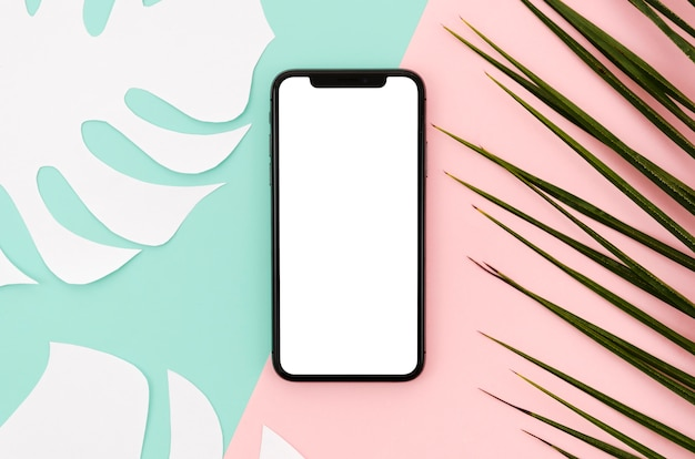 Flat lay smartphone mock-up with leaves