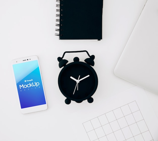 Flat lay smartphone mockup on workspace