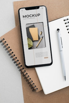 Flat lay smartphoneand notebook