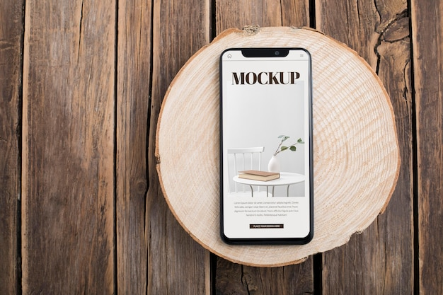 Flat lay smartphone on wooden table