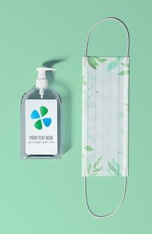Bottiglia di sapone piatta con maschera di protezione