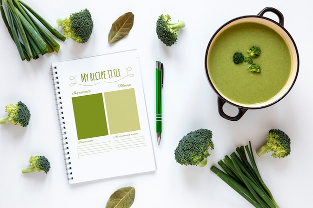 Flat lay soup with arrangement of ingredients and recipe mock-up