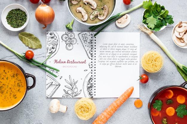 さまざまな材料とレシピのモックアップを添えた平置きスープ