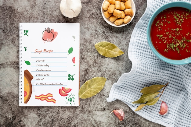 Flat lay soup with composition of ingredients and recipe mock-up