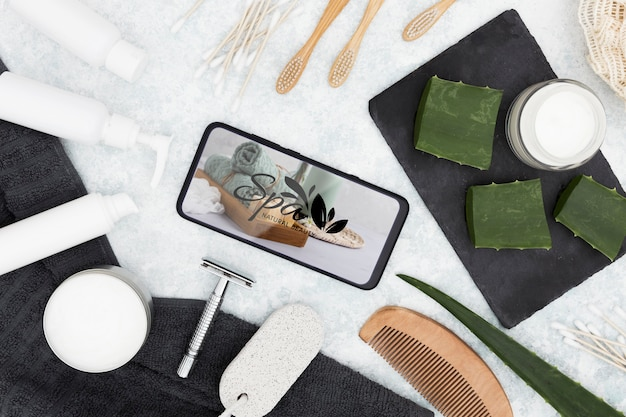 Flat lay spa center mock-up and mobile phone