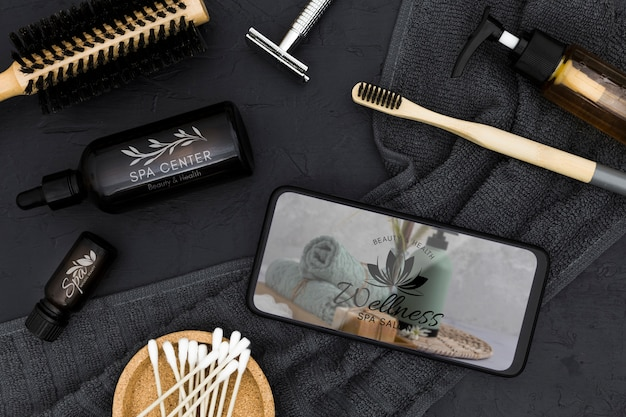 Flat lay spa center mock-up and smartphone