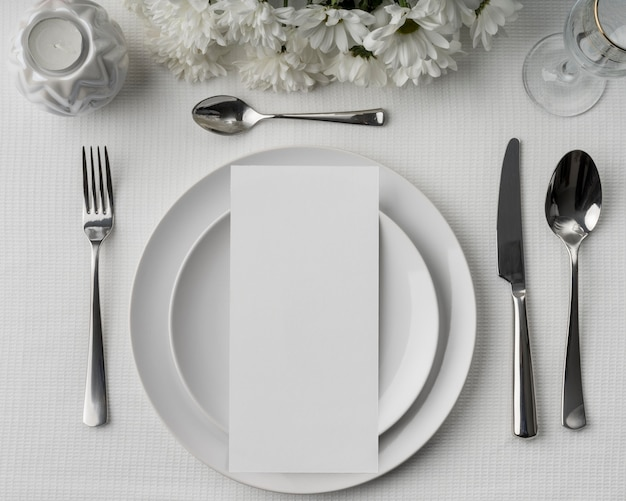 Flat lay of spring menu mock-up with flowers and cutlery on plates