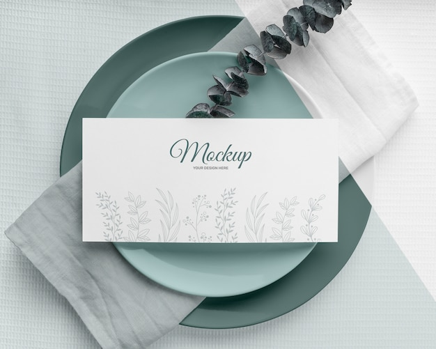 Flat lay of spring menu mock-up with leaves on plates