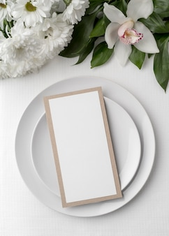 Flat lay of spring menu mock-up with plates and flowers