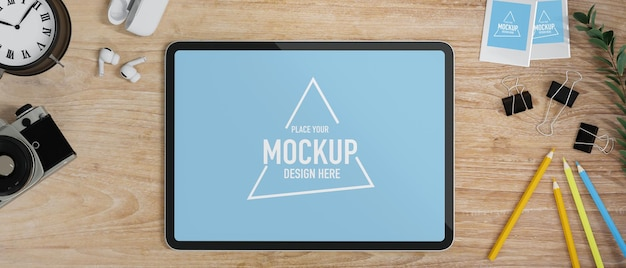 Flat lay study table tablet mockup with camera clock earbuds on wood table online study