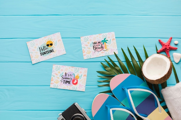 Flat lay summer flip flops with coconut on the table
