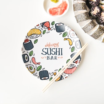 Flat lay of sushi plate and chopsticks on white background