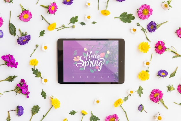 Flat lay tablet mockup with flowers