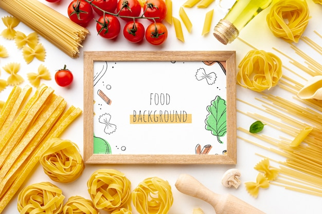 Flat lay uncooked pasta assortment and tomatoes with frame mock-up