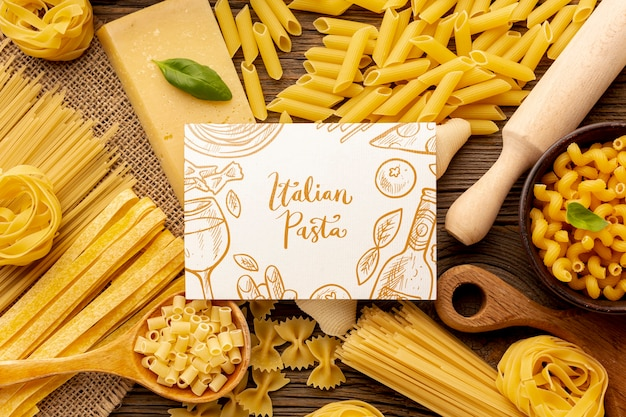 Flat lay uncooked pasta assortment with white rectangle mock-up