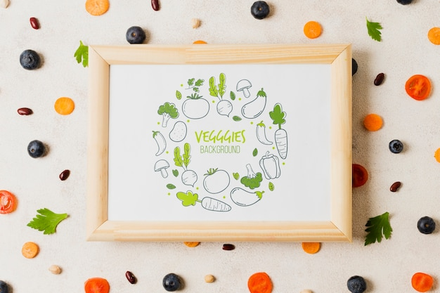 Flat lay vegetables assortment with frame mock-up