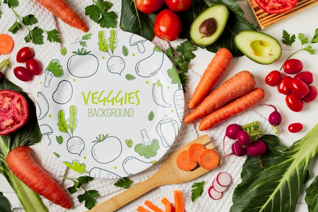 Flat lay vegetables assortment with plate mock-up
