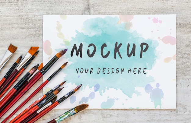 Flat lay watercolor elements composition with mock-up